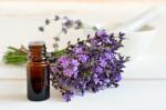 Change Your LifeEssential lavendar oil in dark bottle with lavendar flowers sprig