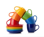brightly colored cups in a curved tower for Nancy Knows Us