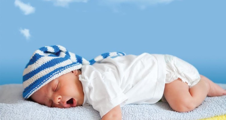 ADHD can result in sleep disorders. Picture isSleeping Baby on blue, yellow, orange and white terry towels, Sleep