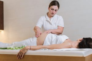 Pregnant woman having a relaxing Reiki treatment
