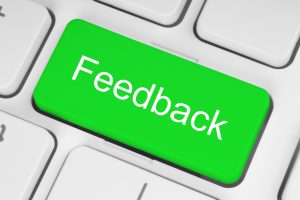 Green feedback button on keyboard ADHD people get lots of negative feedback influencing their self-confidence